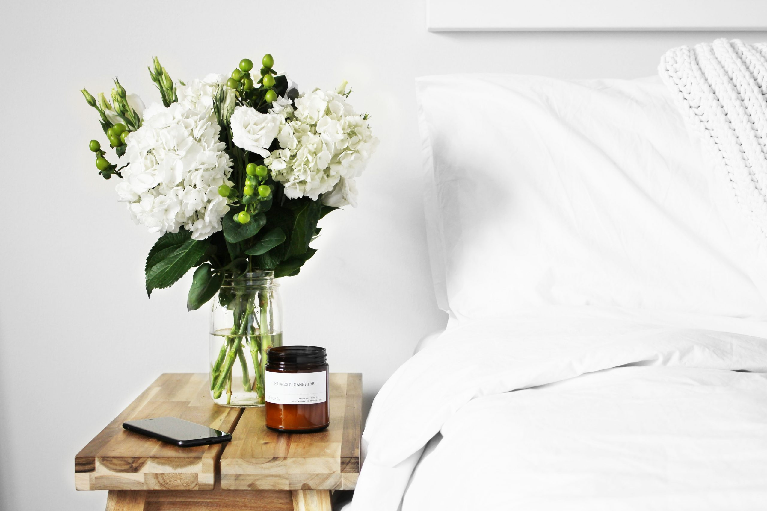 Bouquet of flowers sitting on bedside table to represent sex therapy