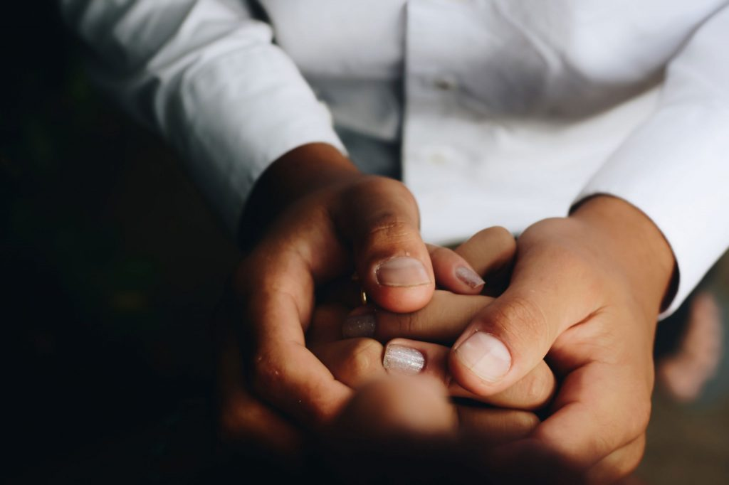 A couple holding hands to represent sex therapy for men
