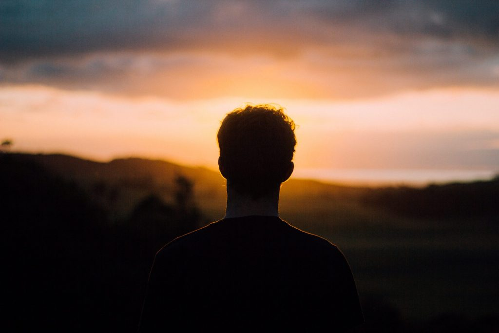 Silhouette of man looking at the sunset to represent sex addiction therapy and out of control behavior
