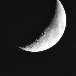 Photo of waxing half moon at night to represent Women's Moon Circle.