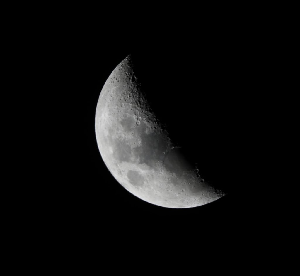 Photo of waning gibbous moon at night representing Women's Moon Circle.